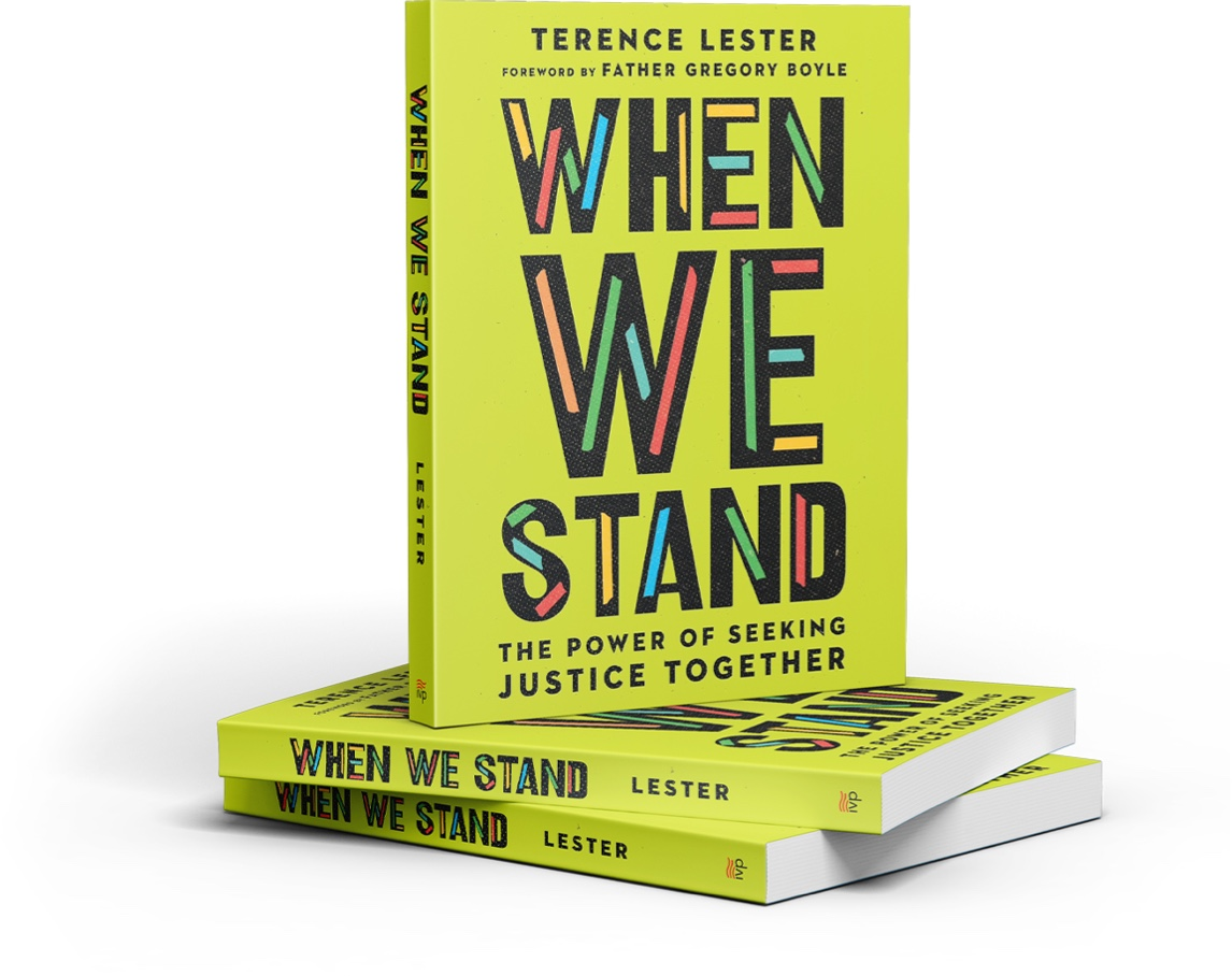 standing book of when we stand book stacked on two other books